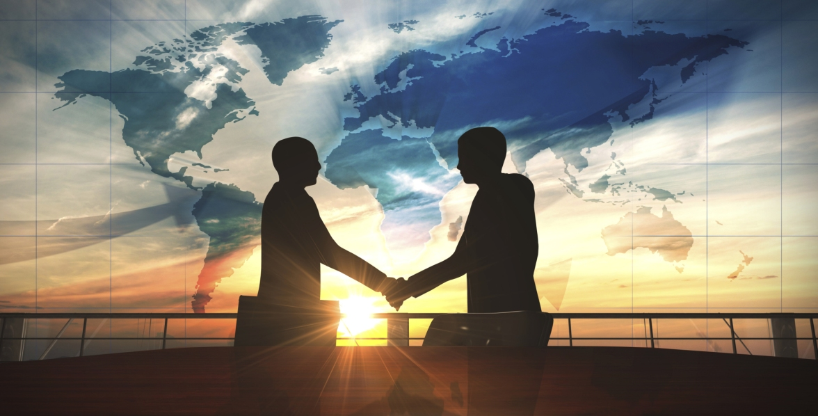 World business shake hand in office silhouettes